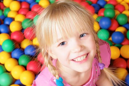 Happy girl on colorful background looking at camera  Stock Photo - 6670155