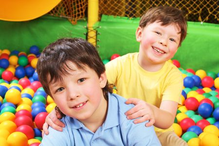 Happy lad embracing his brother and both looking at camera with smiles Stock Photo - 6670132