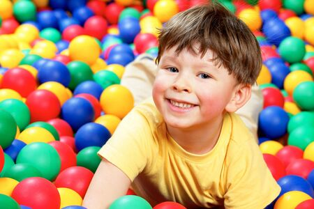 Happy lad looking at camera during play Stock Photo - 6670126