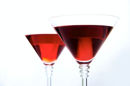 bocal: Martini glass with red wine on background of another bocal