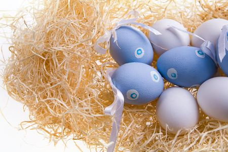 occurrence: Photo of several Easter eggs decorated with ribbons