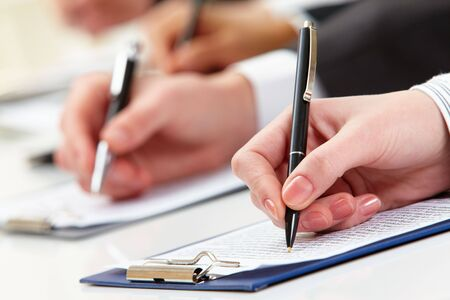 executive courses: Close-up of business person hand working with document