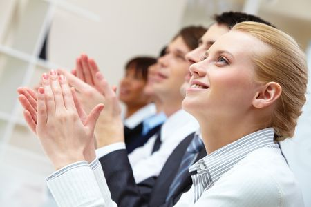 congratulations: Photo of business partners hands applauding at meeting with pretty blonde at foreground