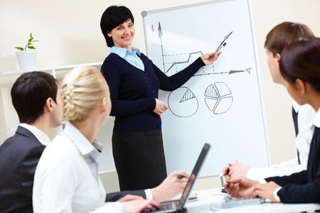 explaining: Image of pretty female looking at camera in working environment