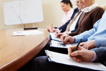 Business people writing in the conference room photo