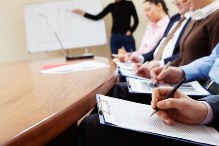 Close-up of businesspeople hands with documents writing at lecture  Stock Photo - 6700247