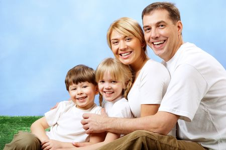 Portrait of joyful family looking at camera and laughing photo