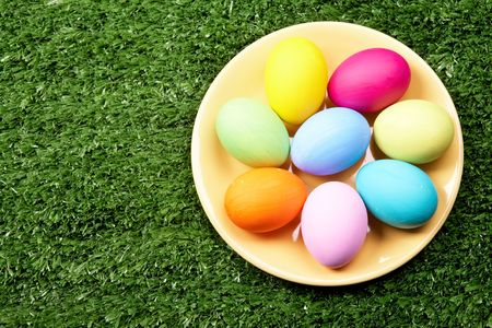 occurrence: Image of several colored eggs placed on plate over grassland Stock Photo