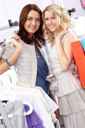 Portrait of two happy women with shopping bags looking at camera with smiles Stock Photo - 6715375