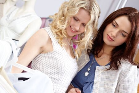 Portrait of young girls in the department store chosing new clothes  photo