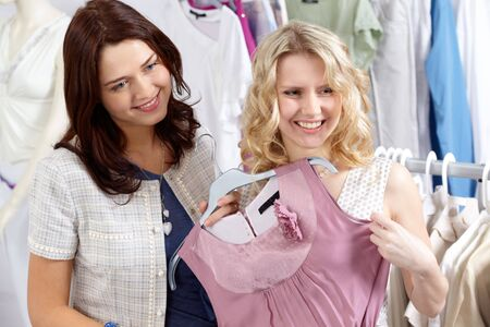 Image of pretty friends chosing new fashionable clothes in the department store Stock Photo - 6700447