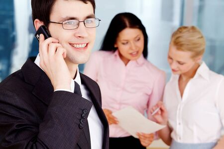 Image of handsome businessman speaking on the phone in working environment Stock Photo - 6700320