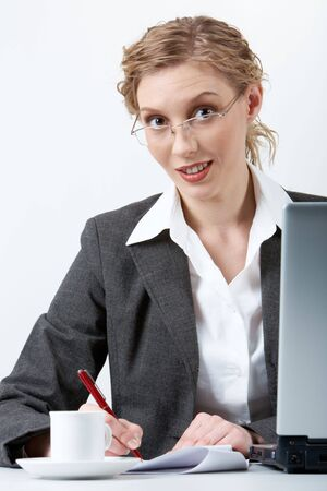 Image of young successful employer planning work in office photo
