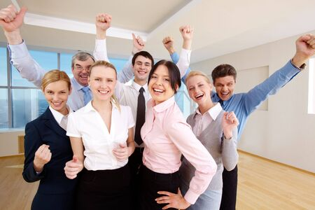 team victory: Portrait of successful people raising hands showing gladness