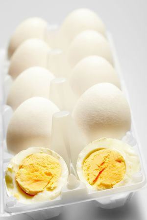 Image of two halves of boiled egg with other ones at background Stock Photo - 6715764