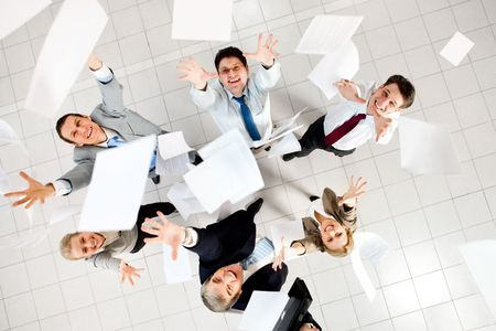 throwing: Above view of several successful partners throwing papers in joy  Stock Photo