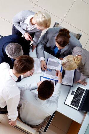 Above view of confident business partners interacting at meeting Stock Photo - 6714288