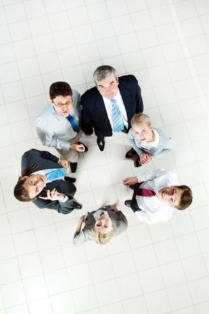 Above view of several business partners standing on the floor and looking at camera Stock Photo - 6714342