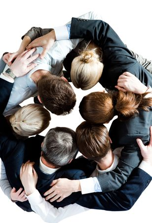 Above view of several business partners embracing each other and making circle photo