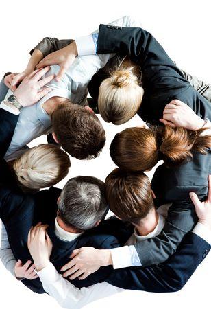 solidaridad: Por encima de la vista de varios socios de negocio abarca entre s� y haciendo c�rculo