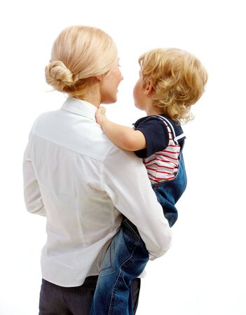 youthful: Image of pretty female holding her youthful son in isolation Stock Photo