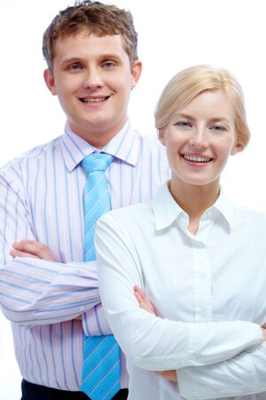 Portrait of successful businesswoman looking at camera with happy partner behind her photo