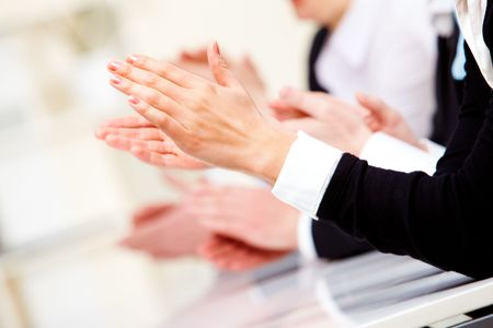people clapping: Photo of business partners hands applauding at meeting