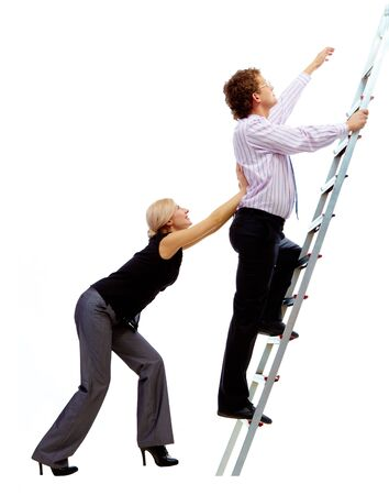 Photo of businessman ascending the ladder with pretty woman helping him photo