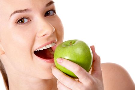 Portrait of pretty girl with open mouth eating green apple  photo