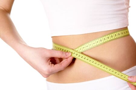 Close-up of female belly with measuring tape around it Stock Photo - 6733778