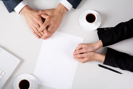 workplace: Above view of business people hands on workplace with blank paper near by Stock Photo