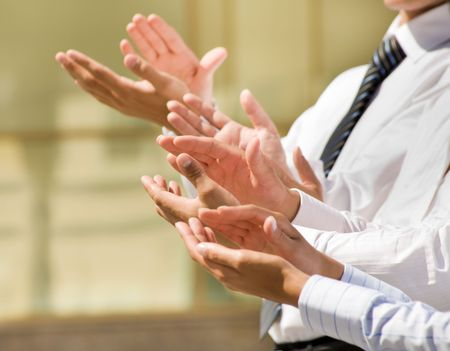 altogether: Photo of business partners hands applauding at meeting