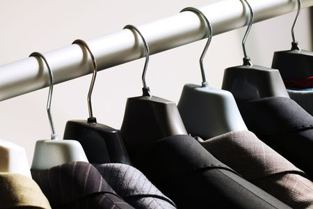 blazer: Photo of hangers with jackets on them in boutique Stock Photo
