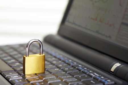 Image of open laptop keyboard with padlock on it photo