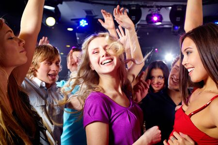 people partying: Image of happy young girls having fun at disco