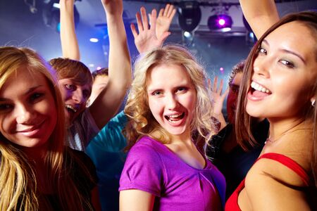 Image of happy young girls having fun at disco  photo