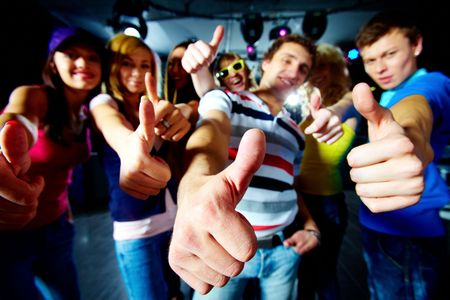 Photo of friends showing thumbs up meaning cool party photo