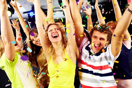 Photo of excited teenagers raising their arms in joy Stock Photo - 6770018