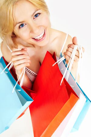 Photo of happy female with colorful shopping bags photo