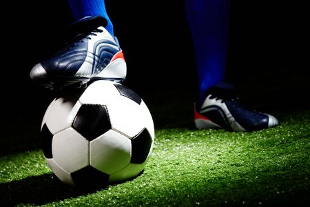 grassfield: Horizontal image of soccer ball and shoes