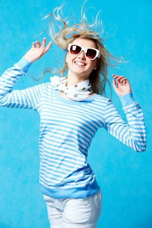 Portrait of young blonde girl in stripped shirt wearing sunglasses photo