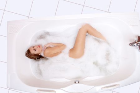 taking bath: Image of slim woman taking bath with bubbles