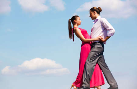 Portrait of passionate couple dancing in open air     Stock Photo - 6813491