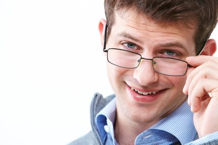 Face of young handsome businessman in eyeglasses looking at camera Stock Photo - 6893409
