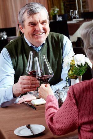 Image of senior couple having dinner at a restaurant  Stock Photo - 6894032