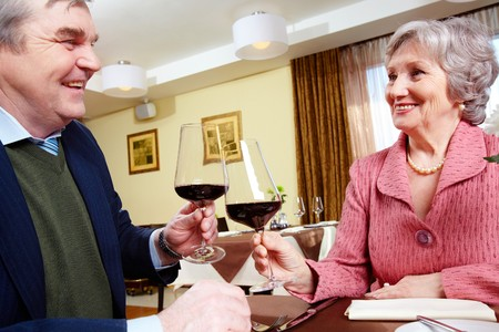 Image of smiling senior couple celebrating their anniversary at a restaurant Stock Photo - 6893421