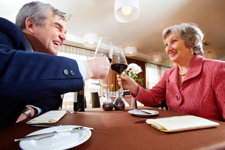 Image of senior couple celebrating at elegant restaurant  Stock Photo - 6893467