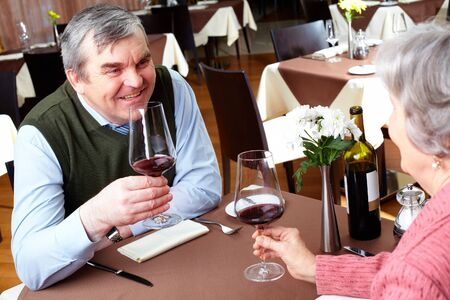 Image of couple with wine glasses sitting at a restaurant Stock Photo - 6894256