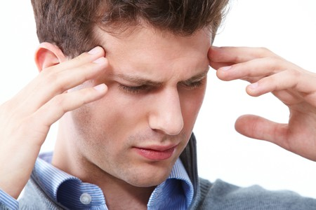 loss leader: Portrait of young man having headache