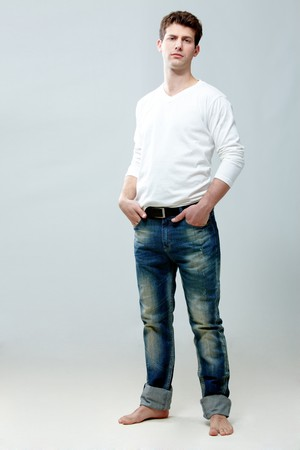 Portrait of young handsome guy wearing stylish clothes in isolation photo